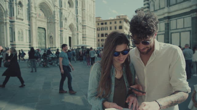 Couple of tourists in Florence, Italy WITH MAP