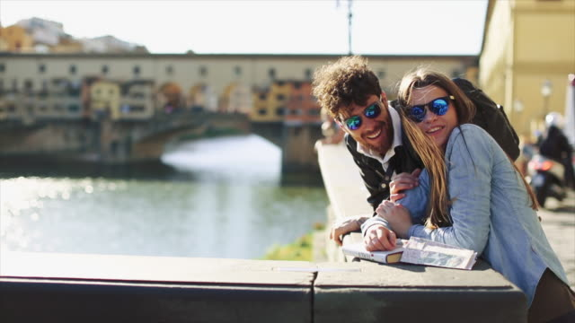 couple of tourists in florence, travelling around italy - sunglasses stock videos & royalty-free footage