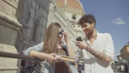 Couple of tourists in Florence, travelling around Italy