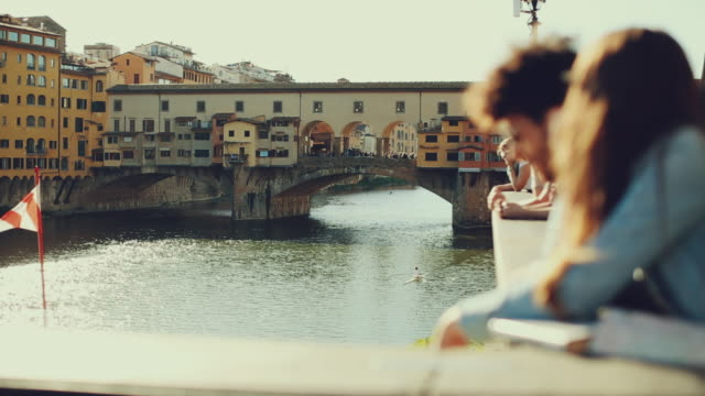 couple of tourists near ponte vecchio, florence - travel destinations stock videos & royalty-free footage