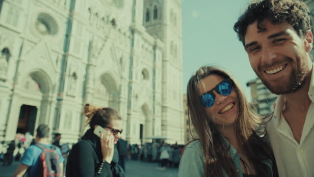 couple of tourists take selfie in florence, italy - europe stock videos & royalty-free footage