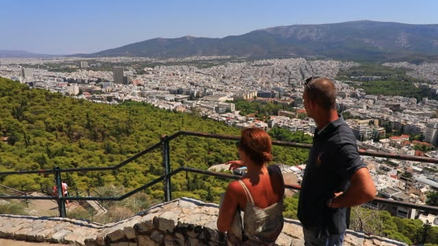 a couple of visitors enjoy the panorama from the lycabettus hill viewpoint on august 23 2020 in athens during the coronavirus pandemic greece is... - lycabettus hill stock videos & royalty-free footage