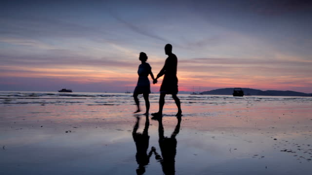 Couple on a Beach in Thailand, Sunset