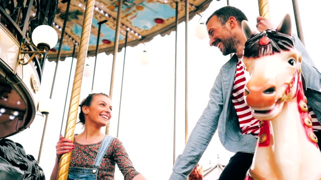 couple on a carousel ride - roundabout stock videos and b-roll footage