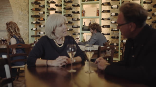couple on a date at wine bar - wine bar stock videos & royalty-free footage
