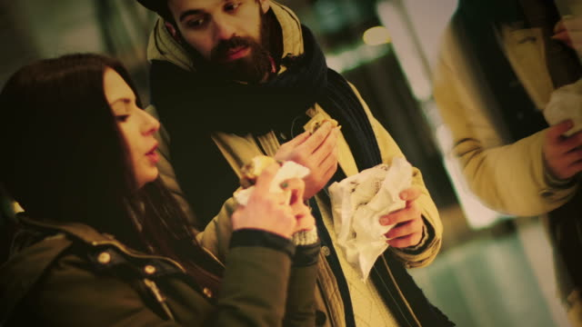 couple on a date eating at the street - date night romance stock videos and b-roll footage
