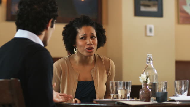 couple on a dinner date having an argument - negative emotion stock videos & royalty-free footage