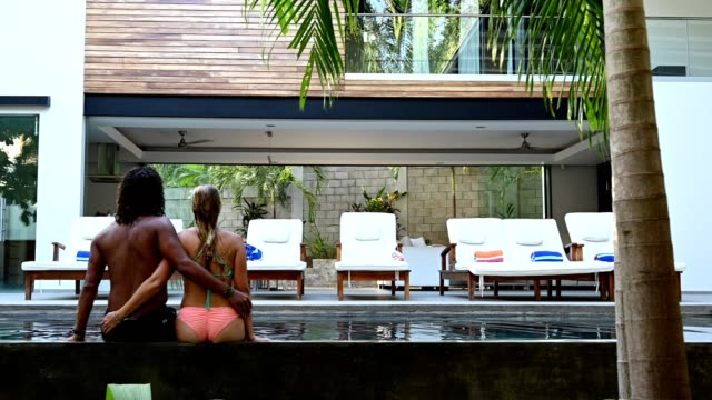 couple on a luxurious vacation at a high end home - poolside stock videos & royalty-free footage