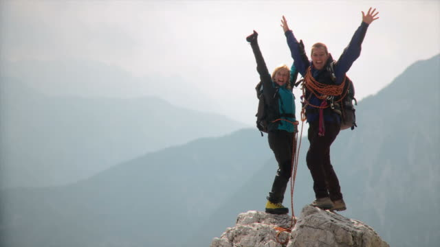 hd: couple on a mountain peak - arms raised stock videos & royalty-free footage