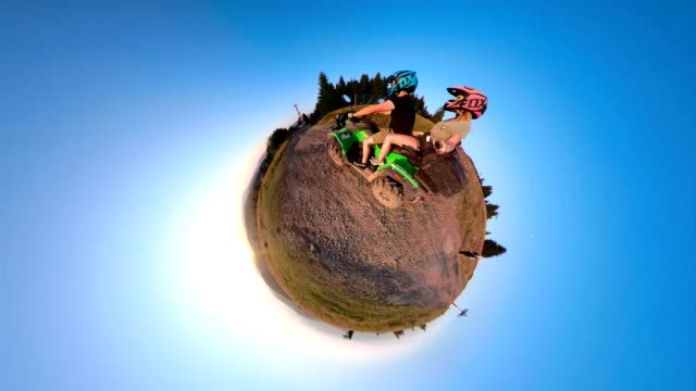 couple on a quadbike filming in little planet format - quadbike stock videos & royalty-free footage