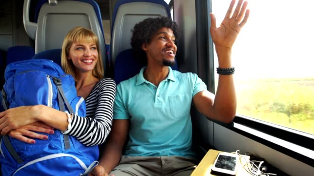 couple on a train. - passenger train stock videos & royalty-free footage