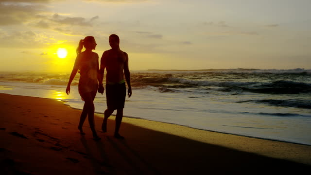 couple on a tropical beach vacation to hawaii for honeymoon - two parents stock videos & royalty-free footage