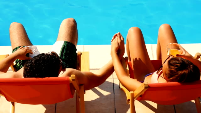couple on a vacation. - poolside stock videos & royalty-free footage
