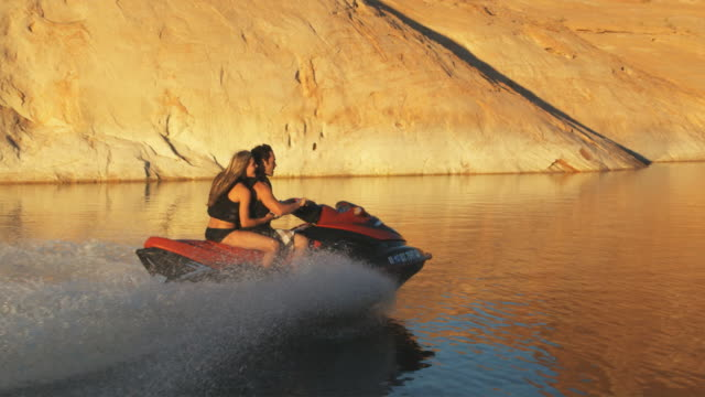 couple on a wave runner - acquascooter video stock e b–roll