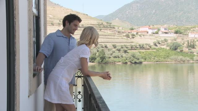 Couple on balcony overlooking douro river