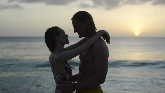 couple on beach at sunset - one piece swimsuit stock videos & royalty-free footage