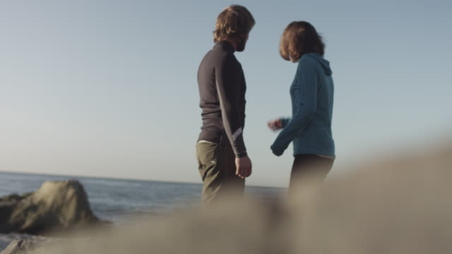 couple on beach, slow motion - aufblenden stock-videos und b-roll-filmmaterial