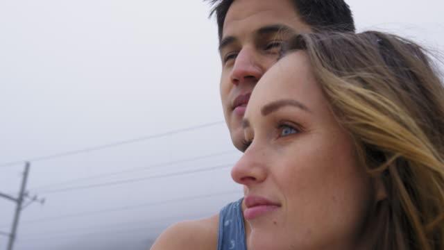 couple on beach - andersherum stock-videos und b-roll-filmmaterial