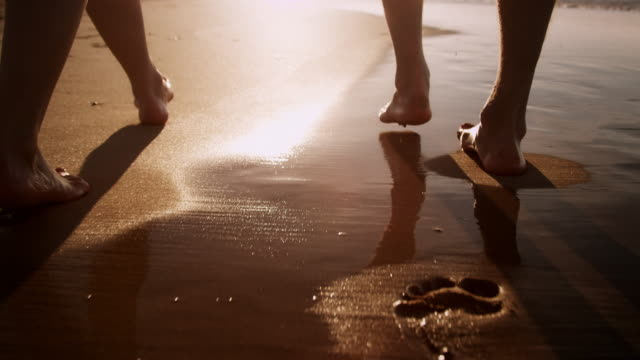 couple on beach - walking stock videos & royalty-free footage