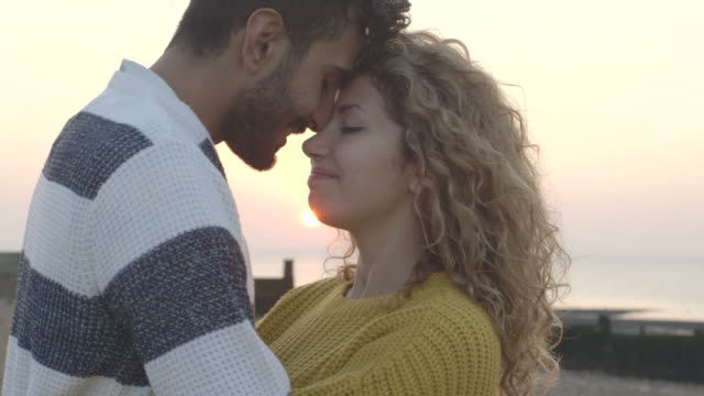 couple on beach - falling in love stock videos and b-roll footage