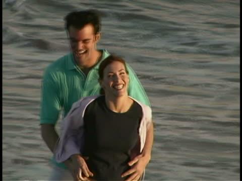 couple on beach - cardigan sweater stock videos & royalty-free footage