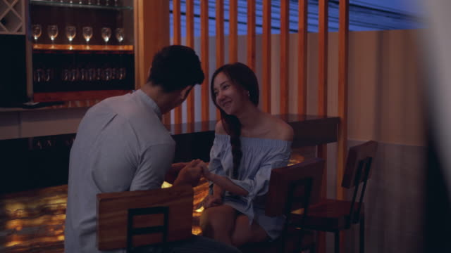 couple on date enjoying evening drinks in bar. - bar drink establishment stock videos & royalty-free footage