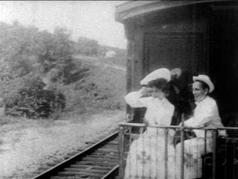 vídeos de stock e filmes b-roll de b/w 1903 couple on observation platform of train looking at countryside / woman is mary murray - 1903