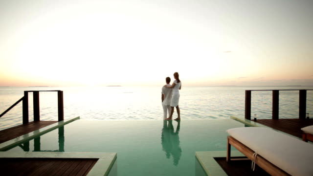 couple on private pool watching sunset - infinity pool stock videos & royalty-free footage