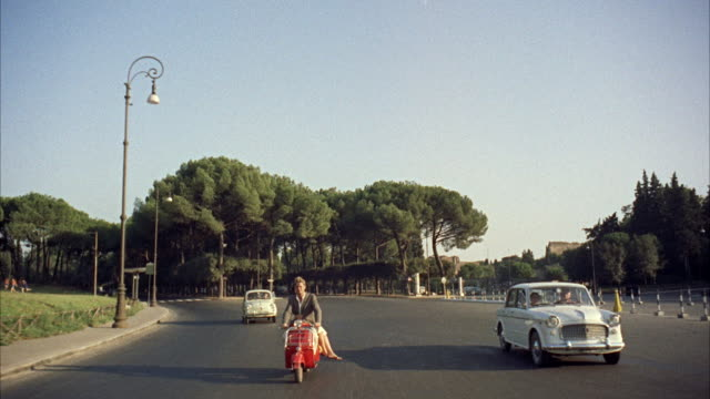 MS POV Couple on scooter in motion  / Rome, Italy