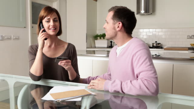 couple on telephone with credit card - budget stock videos & royalty-free footage
