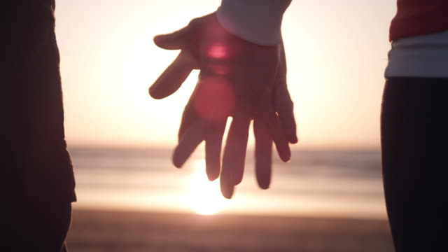 couple on the beach - holding hands stock videos & royalty-free footage