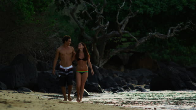 couple on the beach - swimming shorts stock videos & royalty-free footage