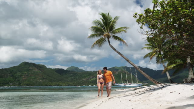 couple on the beach - tahaa island stock videos & royalty-free footage