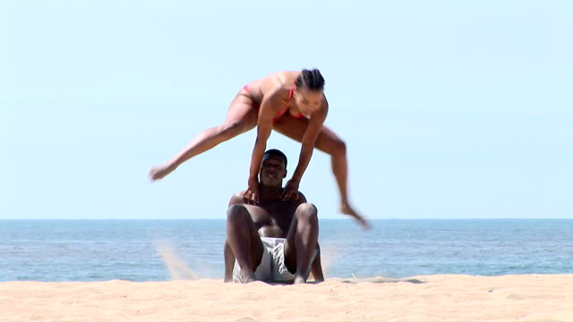 couple on the beach - leapfrog stock videos and b-roll footage