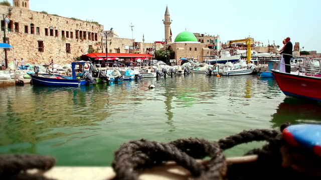 couple on the bow of boat returning from voyage - akko stock videos and b-roll footage