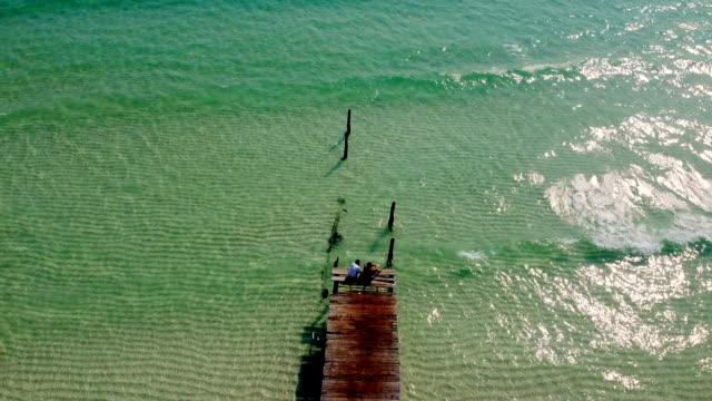 couple on the bridge sea beach on koh rong island dream beach cambodia - gulf of thailand stock videos & royalty-free footage