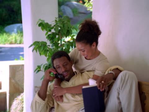couple on the phone - dreiviertelansicht stock-videos und b-roll-filmmaterial