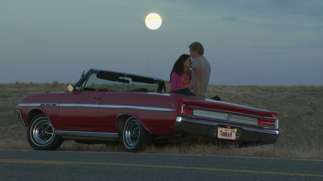 couple on the side of the road in a convertible - see other clips from this shoot 1138 stock videos and b-roll footage
