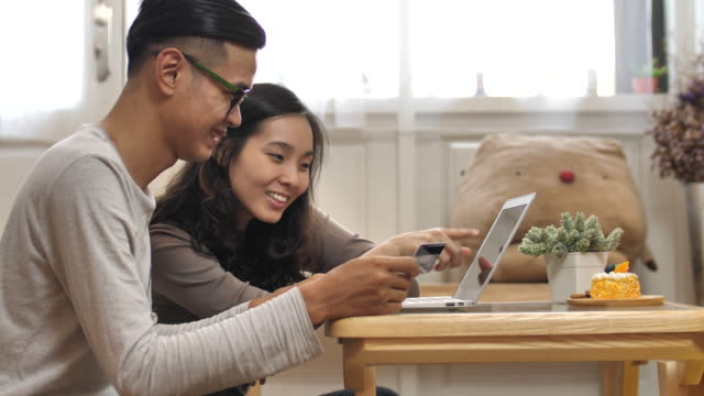 couple online shopping at home - online banking video stock e b–roll