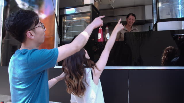 Couple ordering food in a food truck