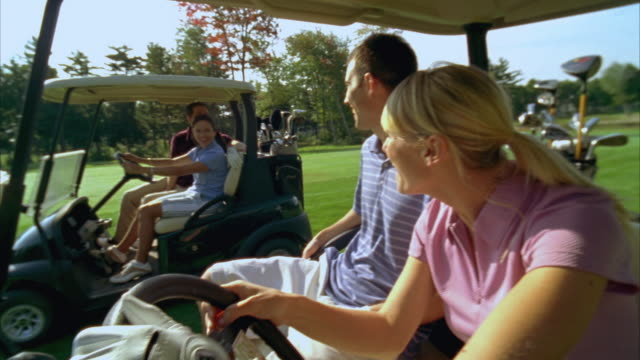 ms, couple overtaking another couple in golf cart, seco, maine, usa - golf cart stock videos and b-roll footage