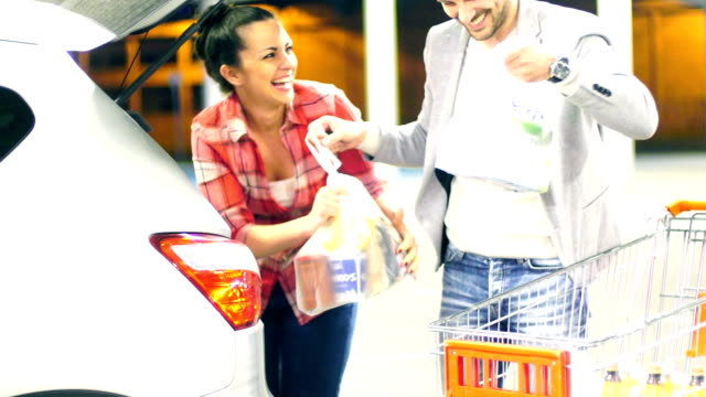 Couple packing their groceries after shopping.