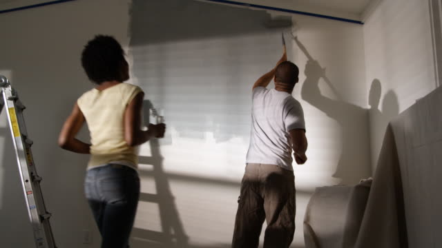 couple painting a bedroom - ladder stock videos & royalty-free footage