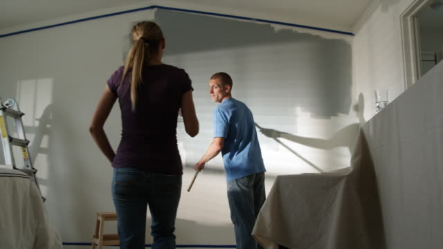 couple painting a bedroom - see other clips from this shoot 1418 stock videos & royalty-free footage