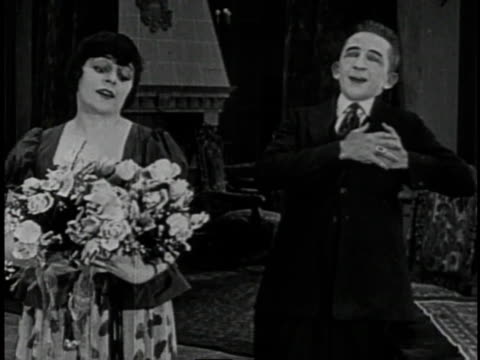 1920 montage couple panics over lizard escaped from bouquet of flowers - romantic comedy stock videos and b-roll footage