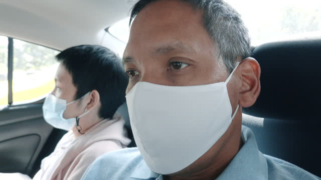 couple passenger wear mask in taxi - passenger stock videos & royalty-free footage