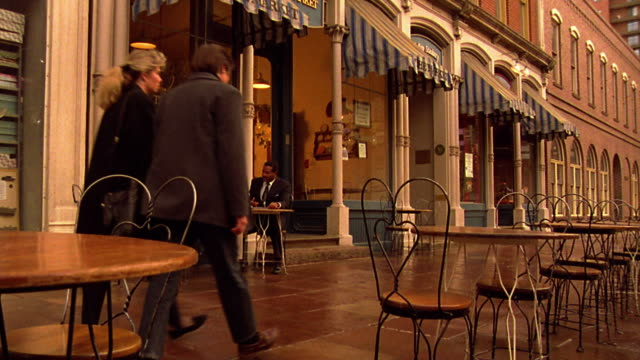 couple passing two businessmen (1 black) at outdoor table at the market cafe / larimer st., denver - 1993 stock videos & royalty-free footage