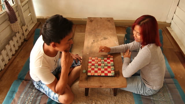 Couple playing draughts