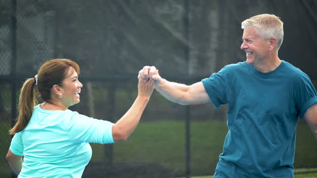 couple playing tennis, high five - tennis stock videos & royalty-free footage