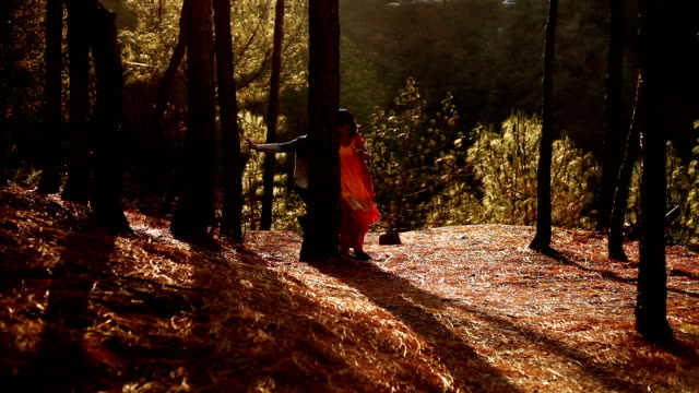 couple playing together between pine trees - ecstatic stock videos & royalty-free footage